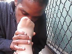 Guy sniffing latinas feet on the street.