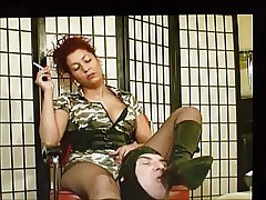 stooge clean boots of his Mistress