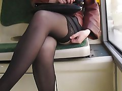 Girl flashing black stockings in a bus