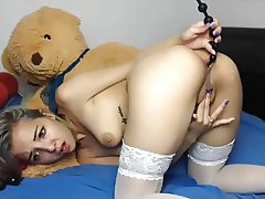 Tanned babe plays with beads in asshole