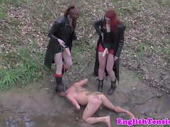 Rough mistresses humiliating subject outdoors