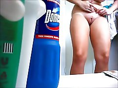 Spycam bathroom. Shaved pussy