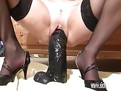 Amateur milf fucking huge dildos in her snatch