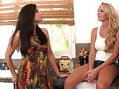 Kinky brunette rubs hot blonde's cunt with her foot