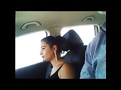 Latina sucks dick with a condom in the car
