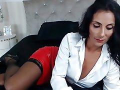 Raven Haired Milf Teases In Leather Skirt &Sexxy Heels