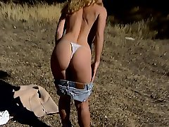 Hot bitch with amazing bouncy tits masturbates outdoors