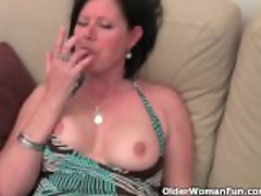 Mature woman with big tits and hairy pussy masturbates