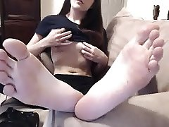 Girl shows feet and tits