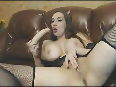 Busty Piercing Brunette with Dildo