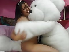 Girl playing with bear