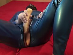 Latex Danielle in blue catsuit play with dild