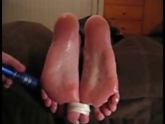 Pretty soles tickled with a vibrator
