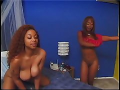 Ebony lesbians fooling with their pussies