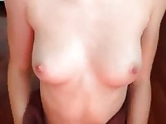 Sexy red head showing off her tits