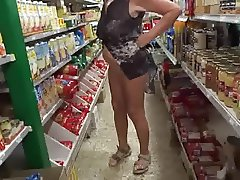 Old bitch shows pussy in store