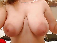Curly brunette with big boobs on cam