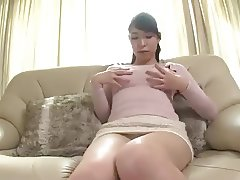 Horny mom masturbates on sofa