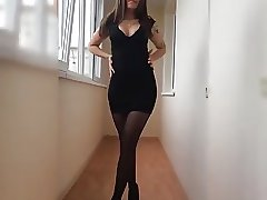 Girl shows off in black pantyhose