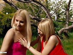 Blondes Rikki and Antonia play with each other outdoors on
