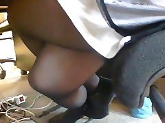 Sexy legs nylon and high heels under the desk