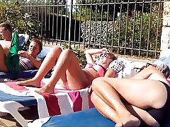mature women and men at pool beach