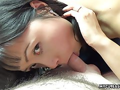 Adorable Asian slut sucking on that veiny cock