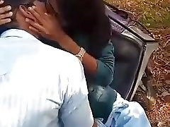 Indian young girl kissing her boyfriend