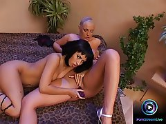 Lesbian lovers kissing, licking, fingering and uses dildo