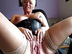 Short haired blonde nympho in stockings sensually fingers