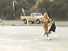 Marilyn Star does naked cartwheels by busy road