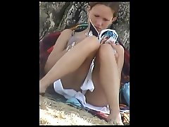 Upskirt young blonde lingerie in a public parc