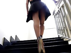 Girl in Little Black Dress. Upstairs Upskirt