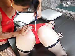 Asian dominatrix shoves toys into sexy brunette's asshole