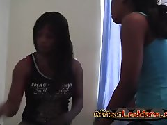 Cute and curious African girls strip and make love on bed