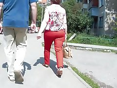Follow big ass milf in red pants