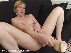 Horny blonde Jacinda fills her pussy with a huge dildo