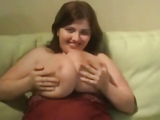 Young mom squeeze her giant milk filled bags