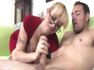 Milf with glasses on knows how to wank a boner