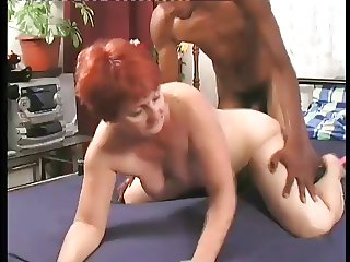 Mature Euro Redhead Enjoys Young Mixed Cock