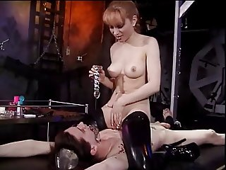 Mistress Lolita fools around with her slave bound to the rack
