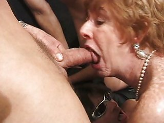 Grandma gangbang slut pleasing several dicks