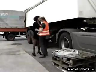 Black prostitute takes on a truck driver trick at the parking lot
