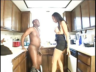 Ebony slut gives her boyfriend a blowjob in the kitchen