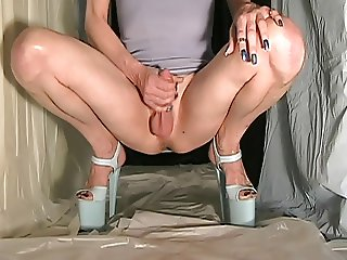 Fanny cd wearing a very short blue dress and 8'' high heels