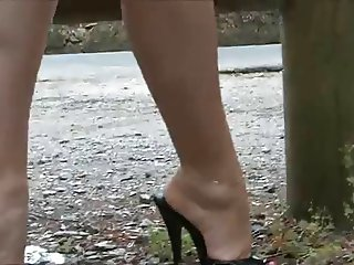 Very nice legs in high heels mules
