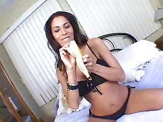 Sexy brunette with banana