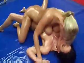 Oiled up babes Lucille and Denise are wrestling on the floor