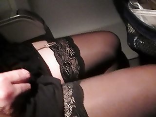 Touching her legs in stockings on a plane