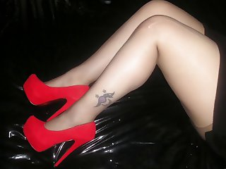 Red high heels and black pantyhose tights